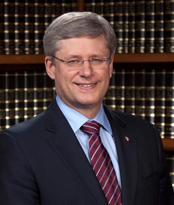 More defibrillators will go into hockey rinks, Harper says