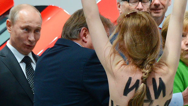 Topless protesters surprise Putin during German trip